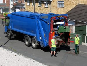 Collecting the waste. A common duty for operatives and a Waste Management Industry Health and Safety Problem.